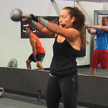 Instructor teaching a kettlebell class