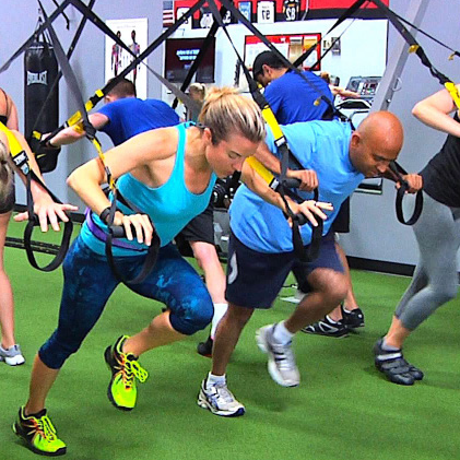 Instructor teaching a TRX class